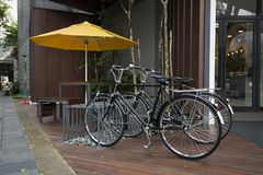 Vintage bicycles in front of a cafe. Vintage bicycles parked in front of a vintage cafe Stock Photography