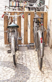 Vintage bicycles for rent close to bookshop Royalty Free Stock Photography