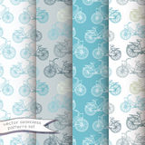 Vintage bicycles seamless patterns set Stock Images