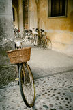 Vintage bicycles on a street. By old building Royalty Free Stock Photography