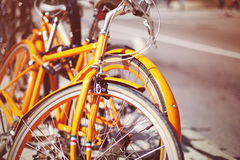 Vintage bicycles in the street. Vintage bicycles parked in a sidewalk Royalty Free Stock Image