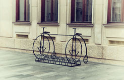 Vintage Bicycles. Two Vintage Bicycles on Historical Square Royalty Free Stock Photos
