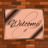 Vintage bienvenu de mur de briques d'en cuivre d'enseigne Photos libres de droits