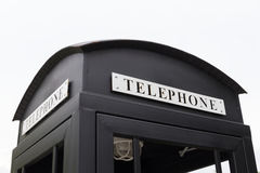 Vintage big black pay phone. Royalty Free Stock Photo