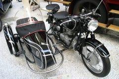 Vintage bike. Vintage motor bike with a sidecar stock images