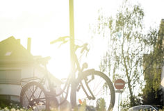 Vintage bike in city at sunset Royalty Free Stock Photos
