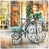 Vintage bike. Cristmas decoration in street, retro styled picture Stock Photos