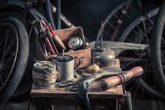 Vintage bike fix service with tools, wheels and tube Stock Photo