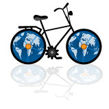 Vintage bike with globe for wheels. Vintage bike with golbe for wheels  environment - eco tourism  concept Royalty Free Stock Image