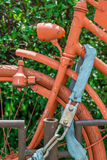 Vintage bike locked and completly painted in orange stock photography