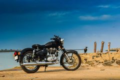 A vintage bike parked near a sea in india Royalty Free Stock Images