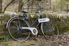 Vintage Bike Resting Against Wall Royalty Free Stock Photo