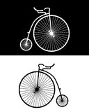 Vintage bikes. Silhouettes of vintage bikes on the black and white backgrounds Stock Images