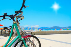 Vintage bikes by hte sea in Alghero Royalty Free Stock Photography