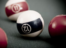 Vintage billard. Balls on green table Stock Photo