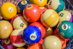 Vintage billiard balls in basket stock images