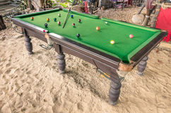 Vintage billiard - Pool table at the beach Royalty Free Stock Photos