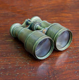 Vintage binoculars. On the wood floor Royalty Free Stock Image