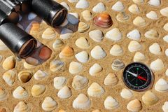 Vintage Binoculars, Compass and Seashells. Marine Background. Royalty Free Stock Photo