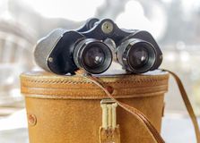 Vintage binoculars sitting on top of leather case Stock Photo