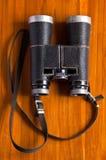 Vintage binoculars on wood Royalty Free Stock Image