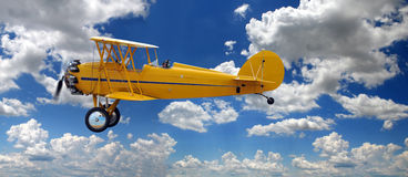 Vintage Biplane Over Clouds Stock Photo
