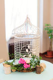Vintage bird cage with peonies Royalty Free Stock Photography