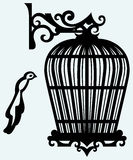 Vintage bird cages. Isolated on blue background Royalty Free Stock Photos