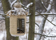 Vintage bird feeders. Handmade. Bird feeder covered with snow. Small depth of field. Royalty Free Stock Photos