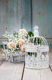 Vintage birdcage, beautiful pink roses and gypsophila paniculata Royalty Free Stock Photos
