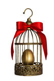 Vintage birdcage with golden egg Stock Image