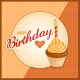 Vintage birthday card with orange cupcake on napkin. Vintage birthday card with handwritten inscription Happy Birthday and realistic cupcake with candle on the Stock Photo