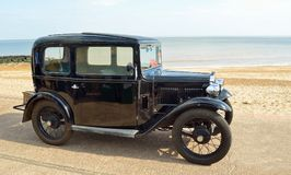Vintage Black Car  parked on seafront promenade. Suffolk England Stock Images