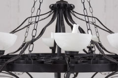 Vintage black chandelier with candles Royalty Free Stock Image