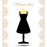 Vintage black cocktail short dress on mannequin with line lace borders for icon. Royalty Free Stock Photography