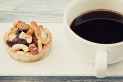 Vintage black coffee and Fruit Tart. On wooden table Royalty Free Stock Photo