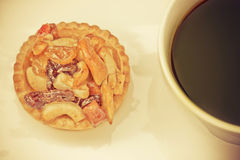 Vintage black coffee and Fruit Tart. On wooden table Stock Image