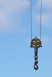 Vintage black crane hook isolated on blue sky Stock Photos