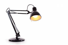 Vintage black desk lamp. Isolated on white Royalty Free Stock Photography