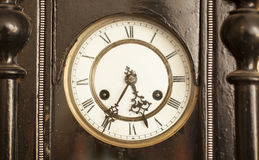 Vintage black dial clock Stock Photos