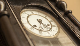Vintage black dial clock. With golden arrows Royalty Free Stock Photography