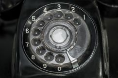Vintage black dial telephone, communication. Old Vintage black dial telephone, communication Stock Photography