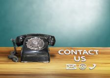 Vintage black dial telephone with email sign. Contact us Stock Photos