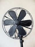 Vintage Black Fan. On Beige Background royalty free stock images