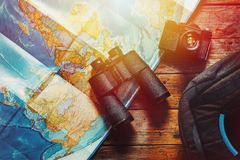 Adventure Discovery Scout Journey Concept. Retro Film Camera, Map, Backpack And Binoculars On Wooden Table, Top View. Vintage Black Film Camera, Map And Royalty Free Stock Photo