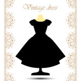 Vintage black fluffy dress on mannequin with line lace borders for icon. Royalty Free Stock Images