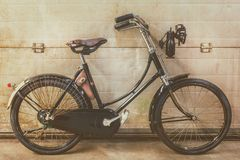 Vintage black ladies bicycle parked in an old factory Royalty Free Stock Images