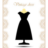 Vintage black long dress on mannequin with line lace borders for icon. Royalty Free Stock Image
