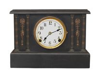 Vintage black mantle clock isolated Royalty Free Stock Photo
