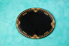 Vintage black oval tray on concrete background royalty free stock photo